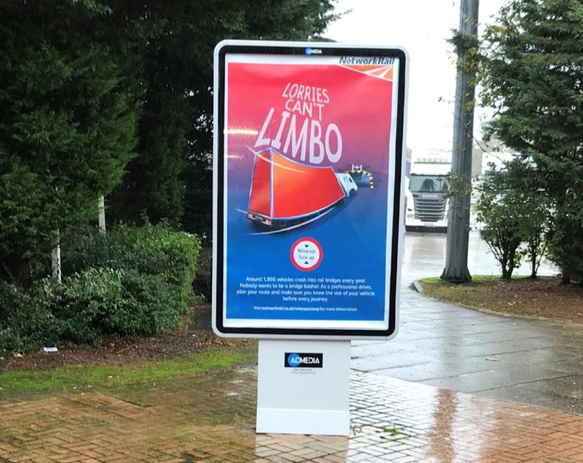 Network Rail bridge strikes poster at motorway service station