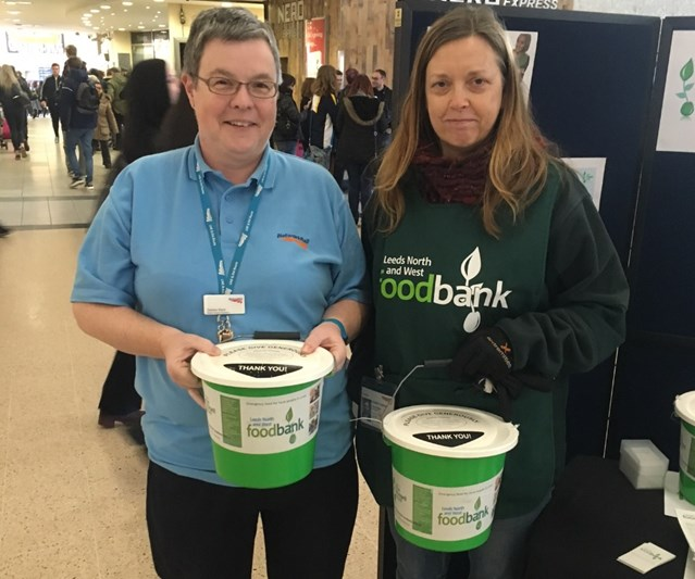 Charity celebrates a year collecting funds at Leeds station: Debbie Ward, Leeds station support assistant and Karen Burgon, project director at Leeds North and West Foodbank-2
