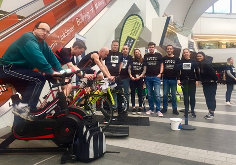 Fundraising team taking part in their cycling challenge in Birmingham New Street station