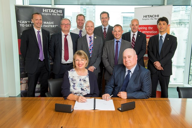Hitachi Rail Europe MD Karen Boswell with Network Rail's Gary Porter celebrate signing the deal to provide Traffic Management to the Thameslink Programme. Also in the picture are the Network Rail and Hitachi teams who will make this all happen