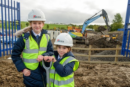 Evie P5 and Lucy P2 help to officially break the ground at their new school