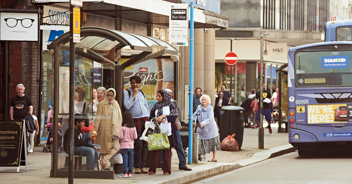 Passengers at bus stop