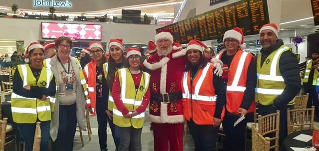 Birmingham New Street Christmas Eve Meal 2019 - volunteers posing with Santa