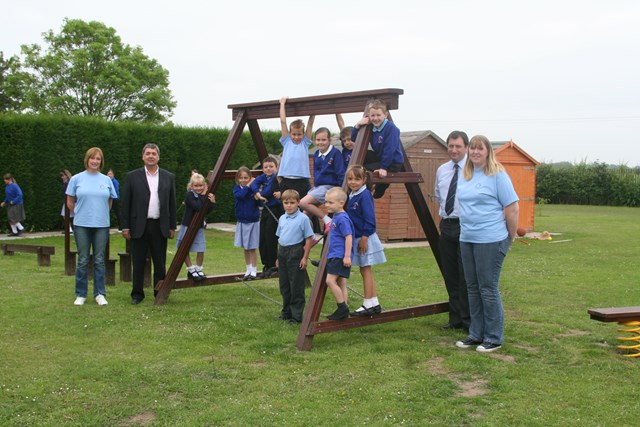 New Play Equipment at Hayes Meadow School: Keith Riley from Network Rail and staff and pupils at Hayes Meadow school enjoy the new play equipment donated by Network Rail and Galliford Try.