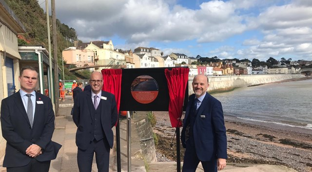 Mike Gallop (middle), Network Rail Western route director, at the first section of the new Dawlish sea wall