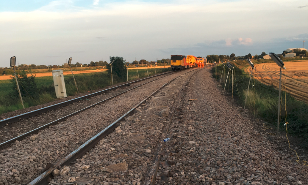 Derailed wagons cleared from the line at Ely as engineers begin to replace the tracks: Engineers start work to replace broken track
