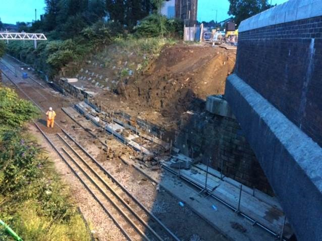 Emergency repairs to bridge means road and rail disruption in Bolton: Moses gate wall collapse