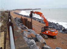 Dover - piling on the beach: Dover - piling on the beach and twin lines of granite rock armour