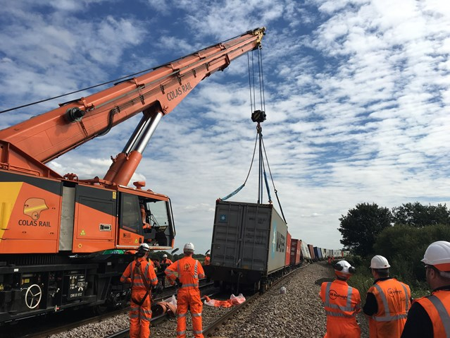 Line between Ely and Peterborough reopens following major recovery operation: Rail crane lifts wagons and containers