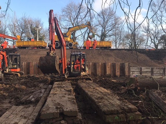 Network Rail reopens Dorking-Horsham railway after 30 metre landslip: Piled wall Ockley awaiting backfilling