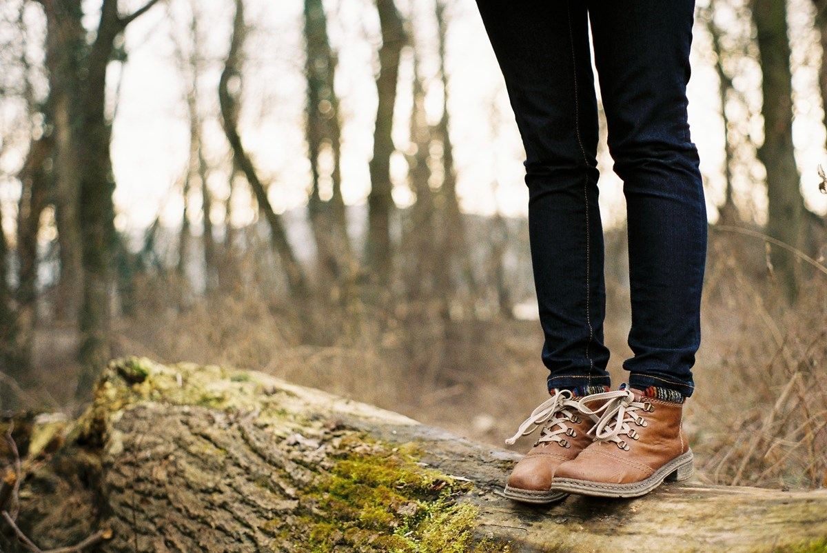 standing on tree trunk