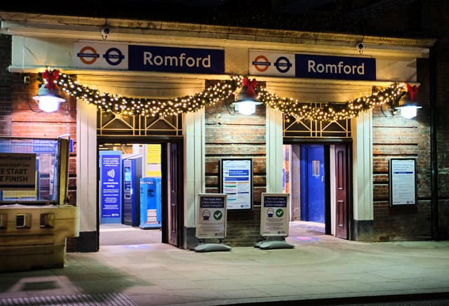 Businesses and rail companies come together to bring Christmas cheer to Romford train station: Christmas garland over the entrance to Romford station