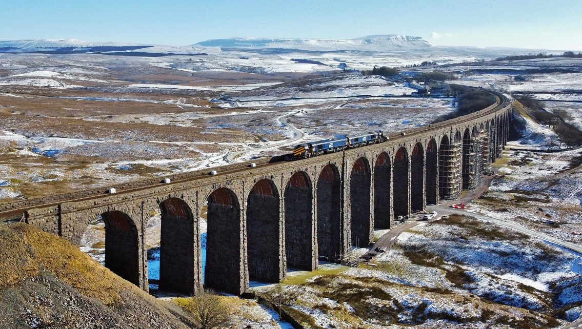 Progress at Ribblehead as plans submitted for extra viaduct repairs: Ribblehead viaduct with Network Rail route proving train and snowplough crossing Feb 11 2021 - Credit Tom Beresford