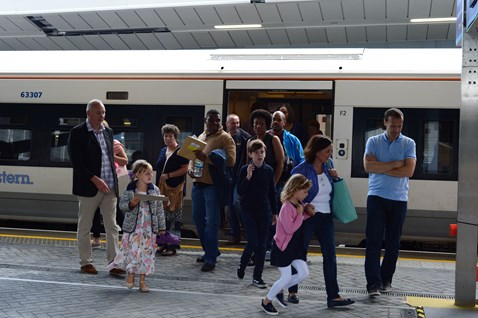 Families arrive at platform 8