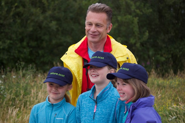 Chris Packham's UK Bioblitz Campaign Visits Flanders Moss National Nature Reserve Investigating the State of Our Nation's Wildlife: Bioblitz Chris Packham with volunteers (l-R) Shona, Niamh, Deia 2