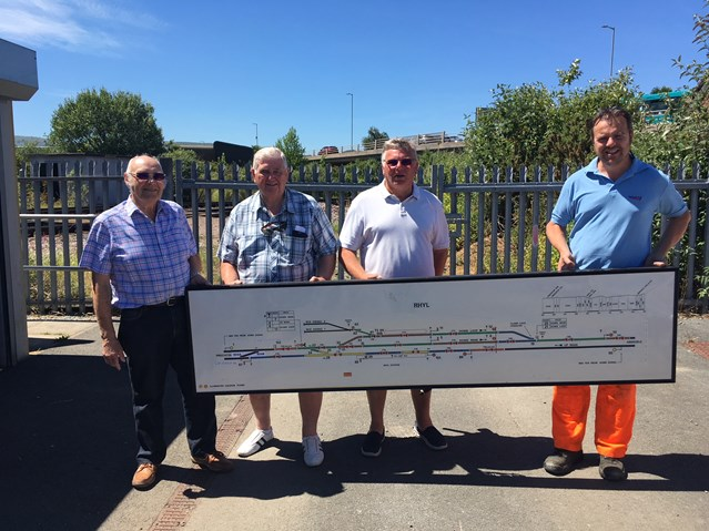 Piece of Rhyl railway history handed over to local model railway club: William Jones, Network Rail, handed over the signal box diagram to Rhyl & District Model Railway Club members Winston Roberts, Arthur Airey and Stephen Cooper