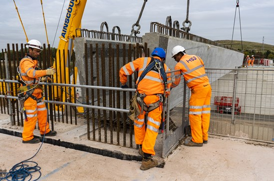 Interchange first beam lift for trace bridge south September 2020: Credit: HS2 Ltd (LM. Interchange, modular, DfMA, pre-stressed, concrete, beam, crane, site, lifting, enabling works, bridge, abutment, modern methods of construction) Internal Asset No. 19172