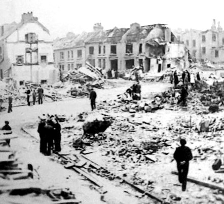Corner of Giesbach Road and Boothby Road, Archway, after the V2 rocket attack. Image Credit: Islington Local History Centre: The corner of Giesbach Road and Boothby Road, Archway, after the V2 rocket attack. The corner and destroyed houses are now covered by Giesbach Road Open Space. Image Credit: Islington Local History Centre