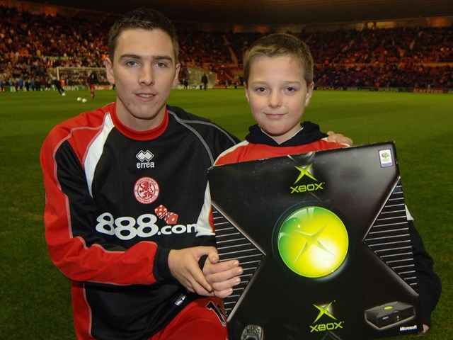 No Messin'! at Middlesbrough FC 1: Kieran Nugent receives his Xbox from Stewart Downing