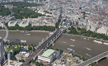 aerial - Charing Cross: Charing Cross, with Hungerford Bridge and the twin Golden Jubilee footbridges. The Royal Festival Hall is at bottom, with Buckingham Palace to the top left and Waterloo Bridge bottom left