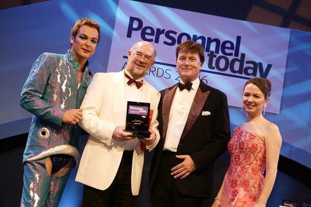 Personnel Today Awards 2006: Shown accepting the Personnel Today Award for Talent Management from Julian Clary is Bob Hughes, Network Rail's talent and employee engagement manager, (second from left) with Tom Barry, UK managing director of Blessing White, which sponsored the award category, and Karen Dempsey, editor of Personnel Today