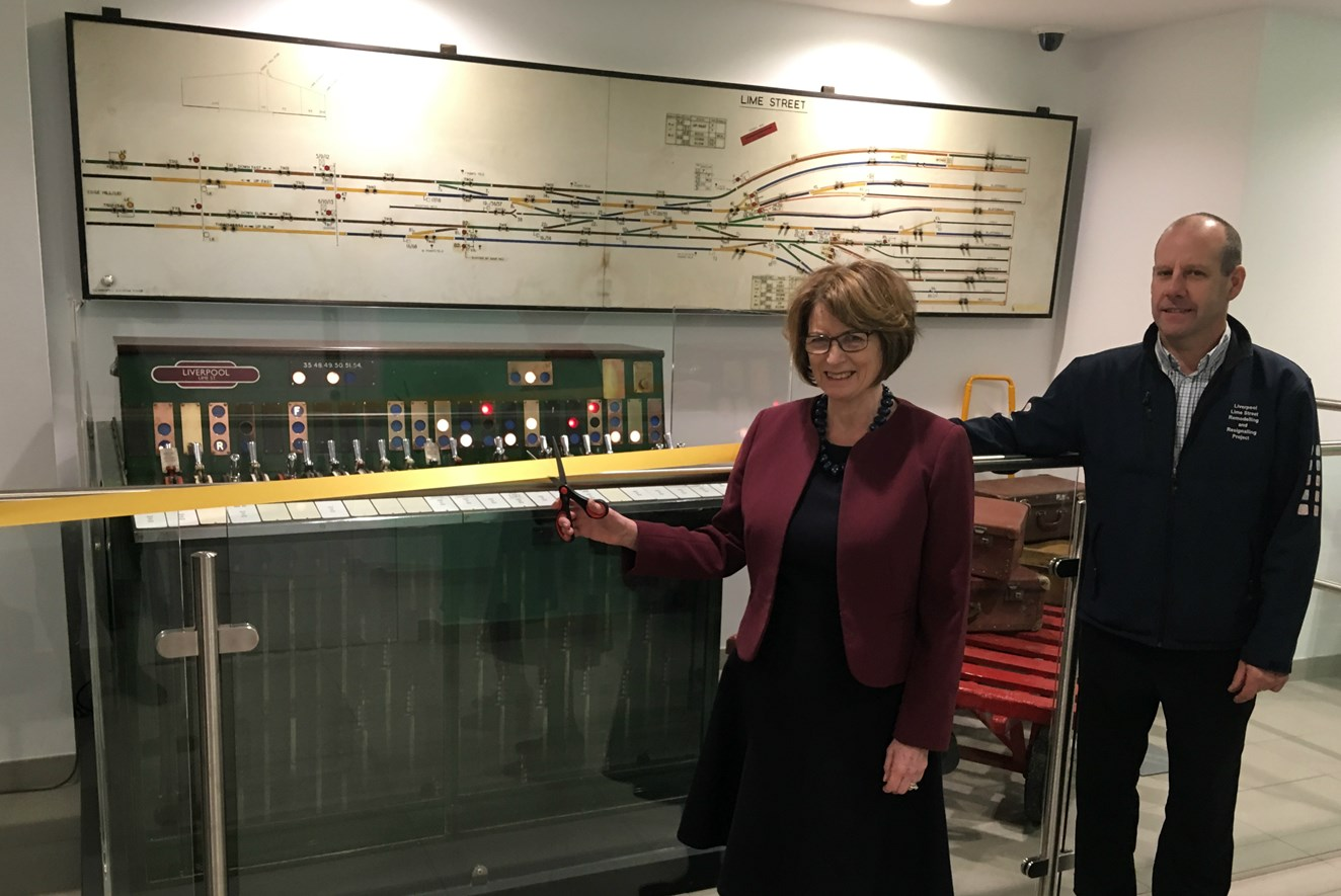 'Mini museum' opens at Liverpool Lime Street to celebrate bygone railway era: Dame Louise Ellman MP cutting the ribbon at the 'Mini museum' opening