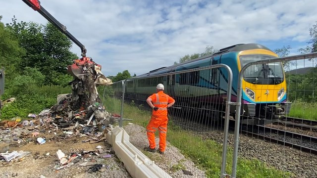 Rat-infested illegal fly tipping cleared from Stalybridge railway: Fly tipping clearance at Heyrod near Stalybridge June 2021