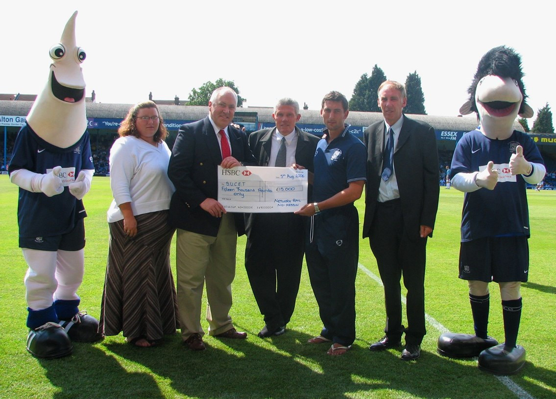 Southend United Cheque Presentation: Network Rail's Route Director Jon Wiseman (3rd left) presents a cheque for £15,000 to Frank Banks, Southend United's Senior Football in the Community Officer (centre) and Southend United's Che Wilson (3rd right) to help tackle railway crime