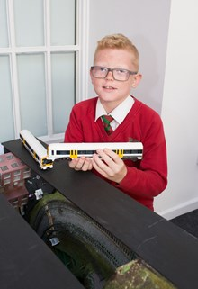 Rail safety model railway: Callum Farthing, 11, with the folding model railway he helped to build with Bognor Regis Model Railway Society