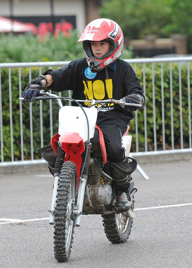 Child tries out a motorbike @ No Messin'! Live, Basildon