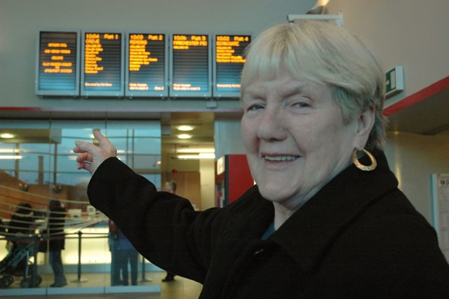 Stockport information screens: Councillor Marueen Rowles pointing to the newly installed information screens above the ticket office at Stockport station (11 December 2006).