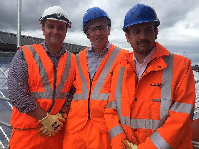Darren Horley from Virgin Trains; Carlisle MP John Stevenson; and Pat Cawley from Network Rail, on the roof of Carlisle station