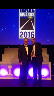 Mark Carne and Tom Crosby, National Rail awards 2016: Tom Crosby (right) accepting his Judges Special Award from Network Rail's chief executive Mark Carne (left), at the National Rail Awards