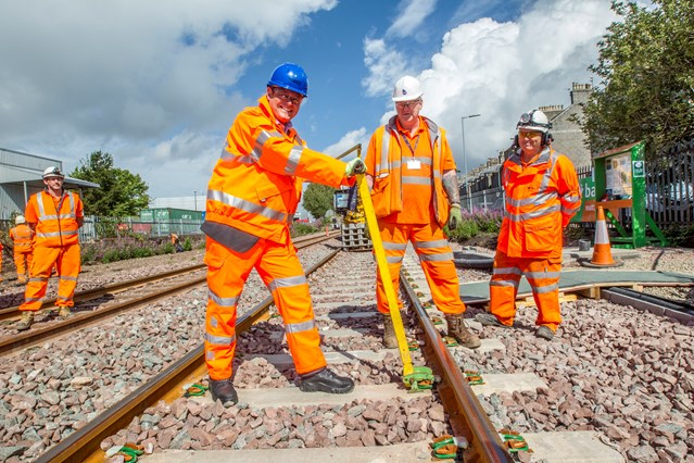 Aberdeen-Dyce rail enhancements on-track for successful completion: Aberdeen track 1 - Alex Hynes helping clip final section of rail into place
