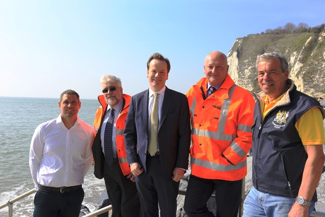 Dover - Shakespeare Beach: Cross-Channel Swimmer Howard James, costain's Charly Clark, MP Charlie Elphicke, Network Rail's Steve Kilby and Channel Swimming Association observer Keith Oiller down on Shakesbeare beach with the cliff behind them