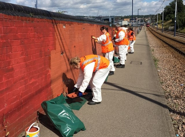 Network Rail volunteers carry out clean up at Sheffield station: Volunteers working on Granville Street in Sheffield-2