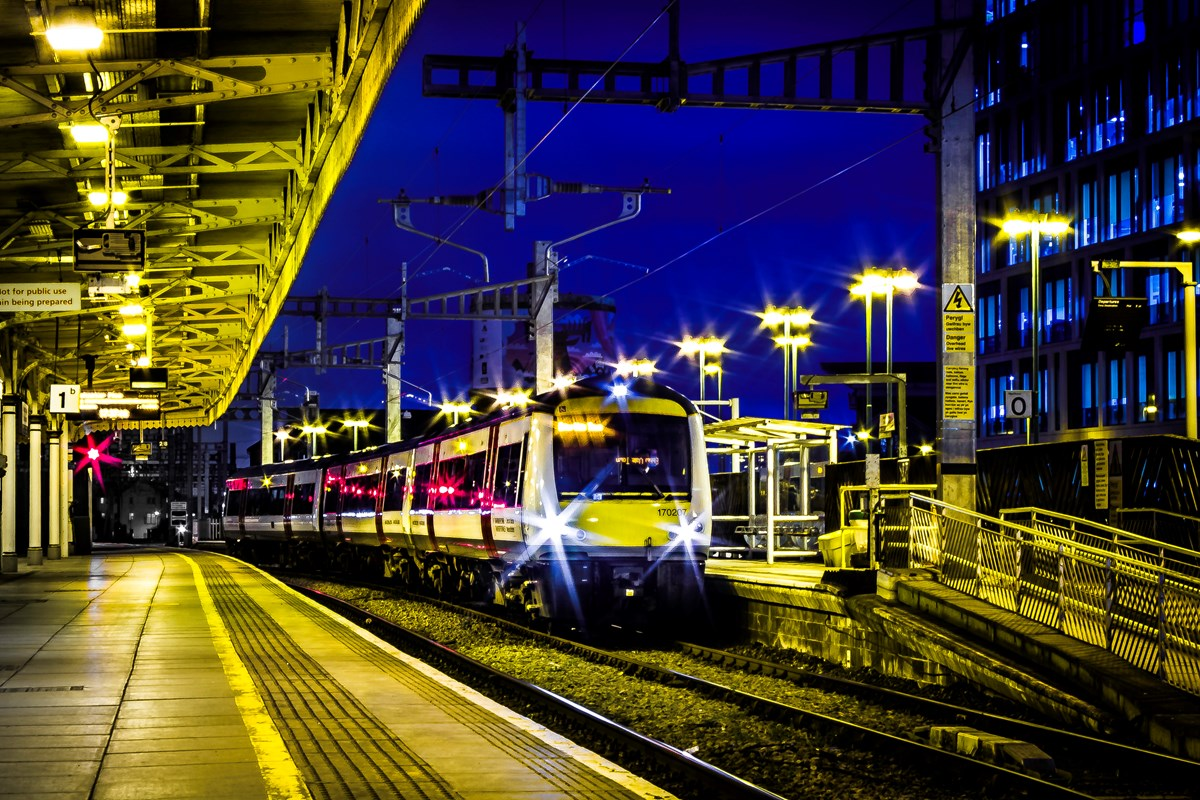 Class 170 at Cardiff Central station at night: Credit: Robert Mann