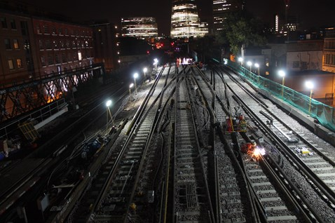 A welder works through the night between London Bridge and Waterloo East
