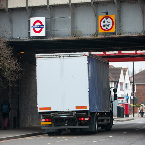 TfL Press Release - TfL works with Ordnance Survey to help reduce unnecessary traffic disruption from vehicles striking bridges across London: Lorry passing underneath a bridge which carries the London Underground network