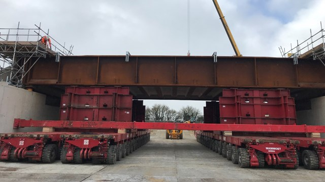 Transporters rehearsing moving the steel deck for vehicle railway underpass project in Bicester