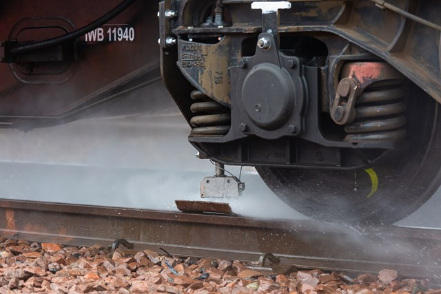 Scotland's Railway ready to keep passengers moving this autumn: Autumn - Water Jetting in action - Rail Head Treatment Train