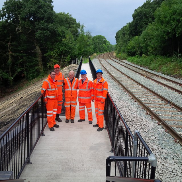 Local politicians inspect landslip repairs on railway between Buxton and Manchester: Cllr Harold Davenport(2nd from right) and David Rutley MP(right) with staff from Network Rail inspecting the site of June's landslip between Buxton and Manchester