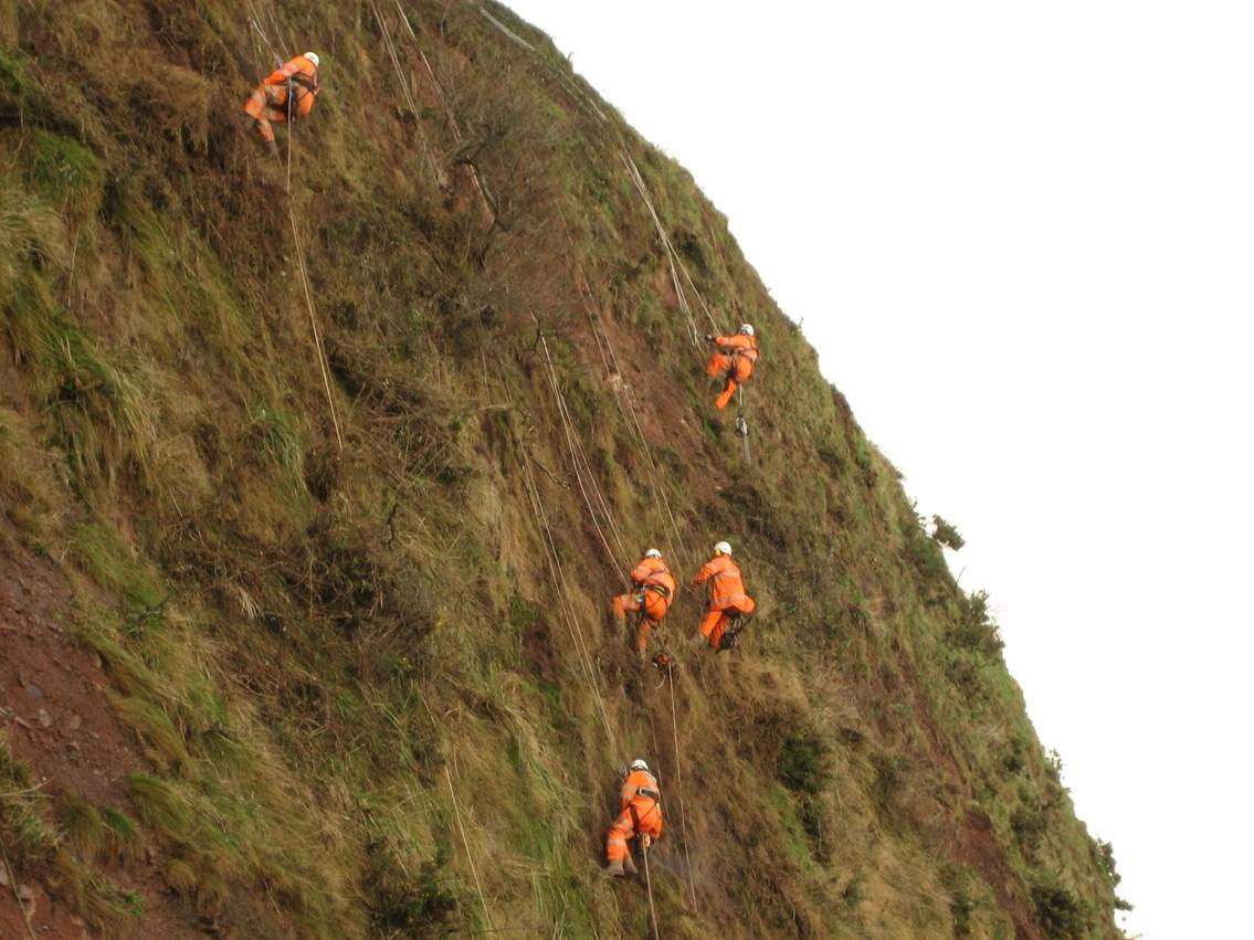 Engineers installing cliff nets on Dawlish seaclif: Dawlish seacliff