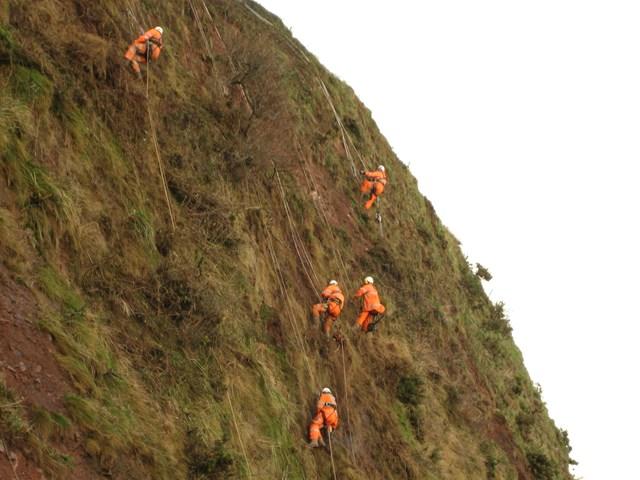 Engineers installing cliff nets on Dawlish seaclif