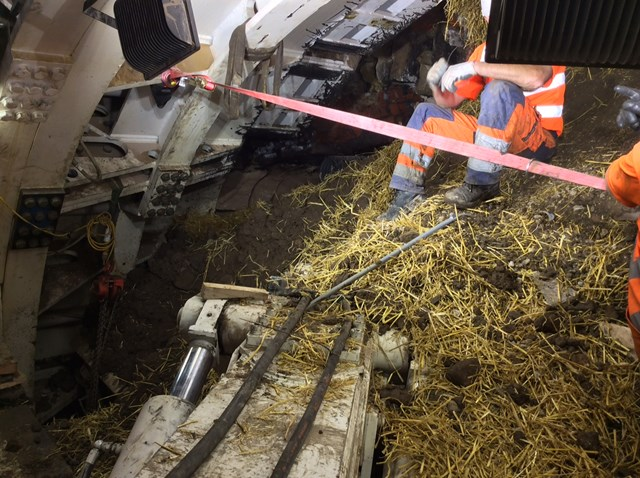 Farnworth Tunnel - engineers on top of material which has poured into the tunnel boring machine