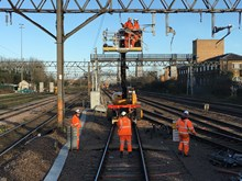 Gidea Park OLE wiring trains putting wire up
