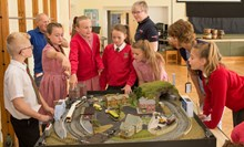 Rail safety model - Bognor Regis: Children from Rose Green School in Bognor Regis compete to spot dangers on the railway thanks to this model by the town's model railway society. Also in the picture are nicola Dooris, network Rail, and Tracey Searle, British Transport Police