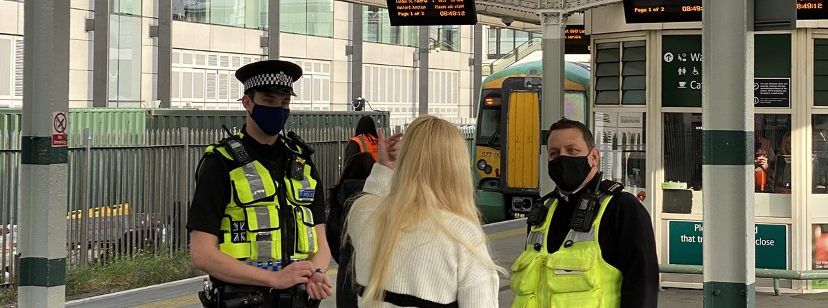 PC Lloyd and Southern employee Phil speak to a member of the public (banner)