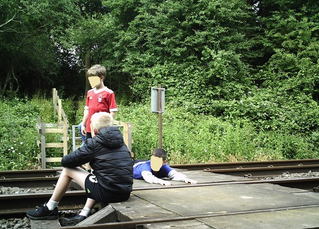 Network Rail and British Transport Police issue further warning in East Midlands as new images show children dicing with death at level crossing: Network Rail and British Transport Police issue further warning in East Midlands as new images show children dicing with death at level crossing 1-2