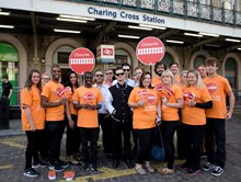 Leafleters at Charing Cross: The leafleting team with the band outside Charing Cross station
